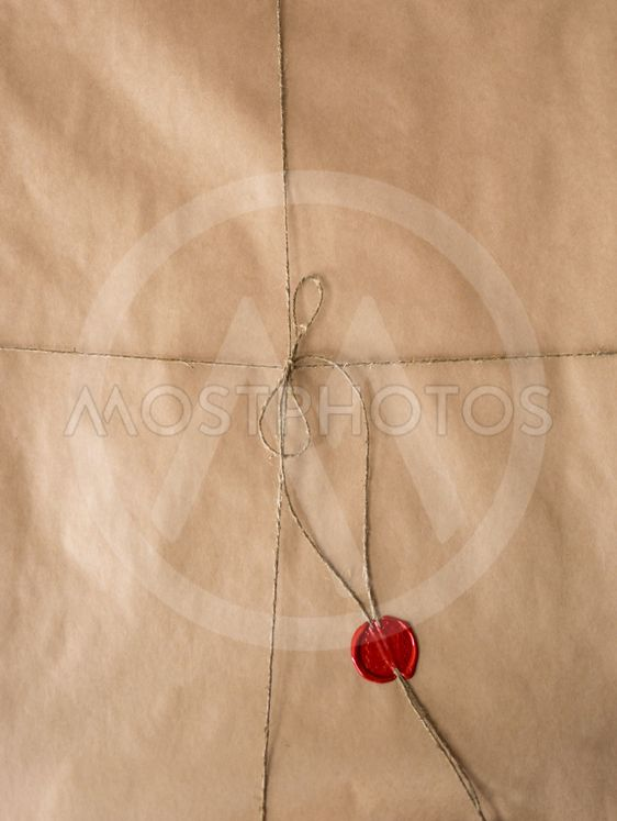 old paper with red wax seal and twine