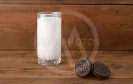 Many OREO sandwich cream biscuits and milk glass on...