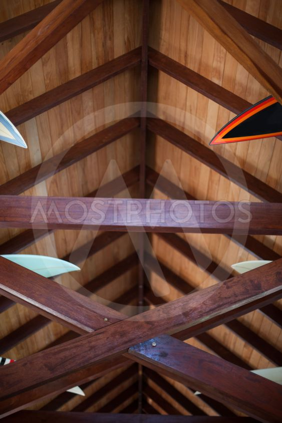 House ceiling with tips of surfboards