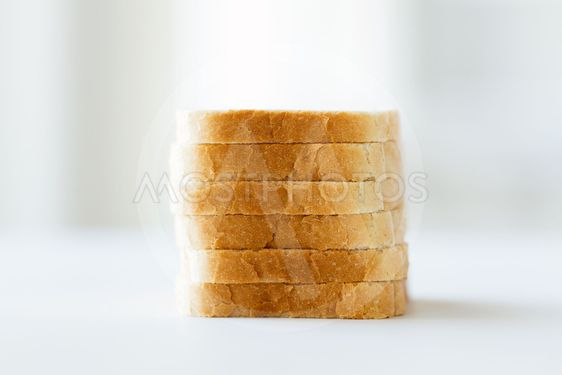 close up of white sliced toast bread pile on table