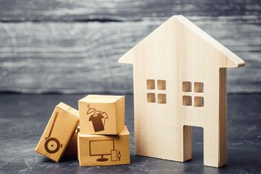House and boxes with delivered ordered goods....