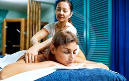 Woman having massage with an oil.
