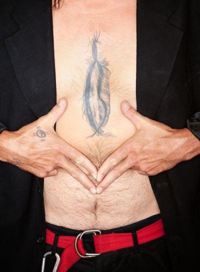 Mixed Race Man Framin Feather tattoo