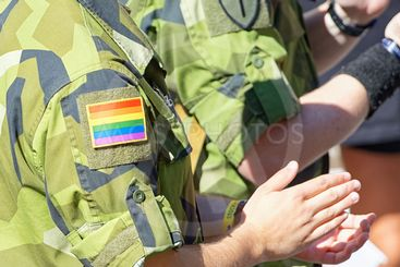 Swedish military with rainbow insignia on camoflage...