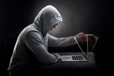 hacker in a hood
