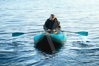 Fisherman in Rubber Boat