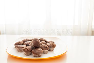 Tasty chocolate muffins in a white plate