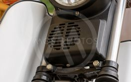 Close up detail of the headlamp on a white scooter