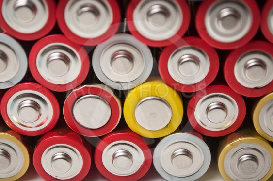 red and silver aa alkaline batteries stack on full frame