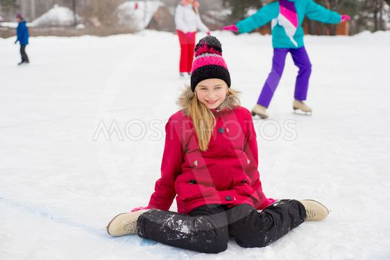 skater girl sitting on the ice