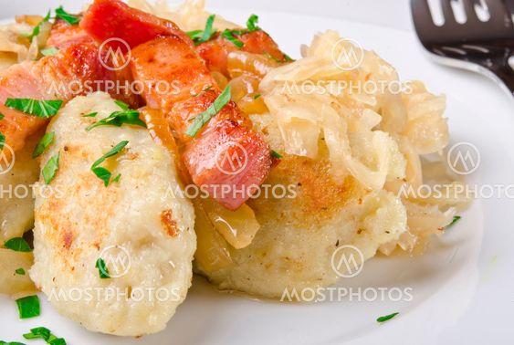 Silesian potato dumplings with smoked pork and sauerkraut