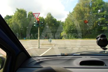 View from the car on an intersection with a traffic light