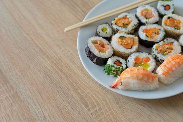 Closeup on sushi set of maki with chopsticks