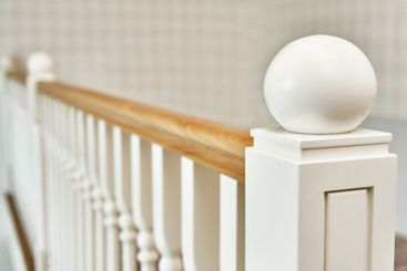Detail of wooden staircase in bright apartment