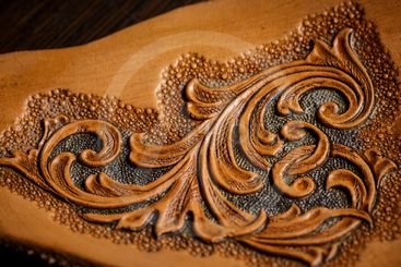 embossed pattern on the leather in the workshop