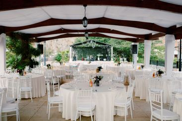 Wedding dinner table reception. Round tables with white...