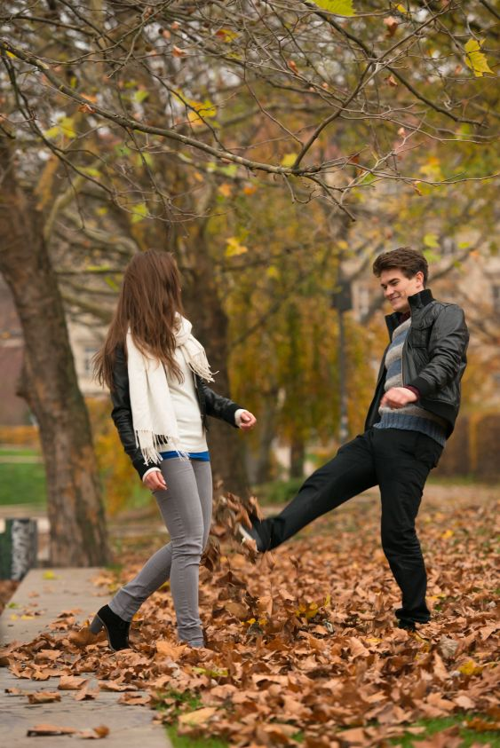 Happy young Couple in Autumn Park