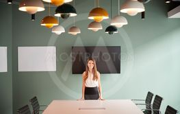 Portrait Of Young Businesswoman Standing By Boardroom...