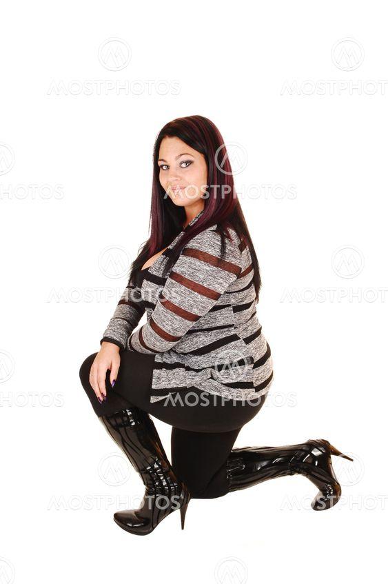 Girl in boots kneeling.