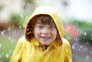 Beautiful little kid boy on way to school walking during...