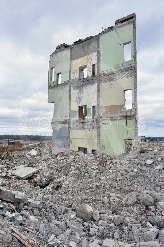 Pieces of Metal and Stone are Crumbling from Demolished...