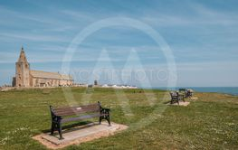 Park benches and church at Newbiggin in Northumberland