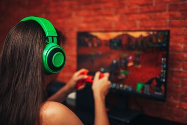 young girl playing game on computer, banner