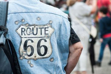 biker with route 66 blue jeans vest