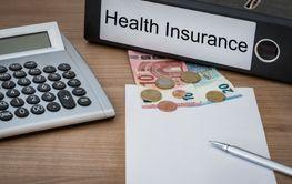 Health Insurance written on a binder