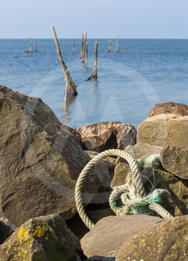 Dutch sea with fishing nets and anchoring rope