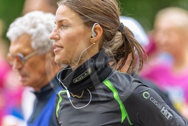 Closeup of a woman with earplugs in ASICS Stockholm...