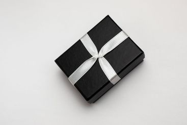 Small rectegular black gift box on a white background
