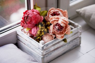 peony artificial rose in a box, standing on the...