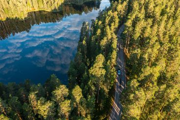 Aerial view of ridge road forest and lake in the morning