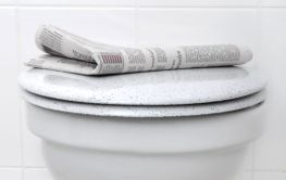 Toilet and newspaper