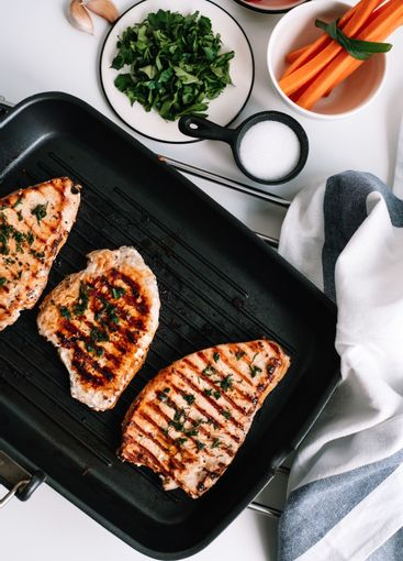 Grilled turkey steak with herbs and spices in black...
