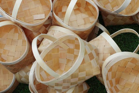 Large wicker striped baskets with handles made of...