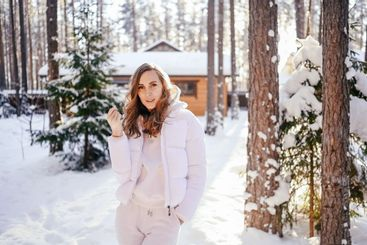 Winter sunny cold portrait in snowfall of beautiful...