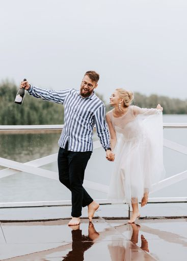 Beautiful just married dance barefoot and have fun on...