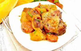 Chicken roast with pumpkin and carrots on board