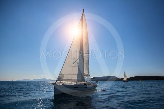 Luxury sailing ship yachts boat with white sails in the...
