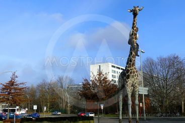 Panorama of a city with a sculpture of a giraffe