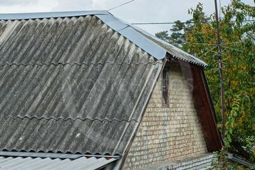 brick attic of a house with a small window