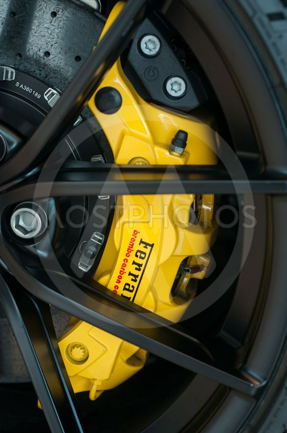 yellow brake on ferrari sport car in ferrari retailer...