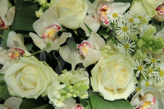 Orchids and roses in bridal bouquet