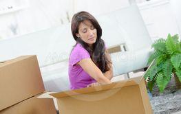 serious woman unpacking box