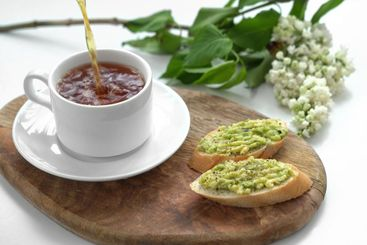 healthy breakfast. tea and sandwich with avocado.
