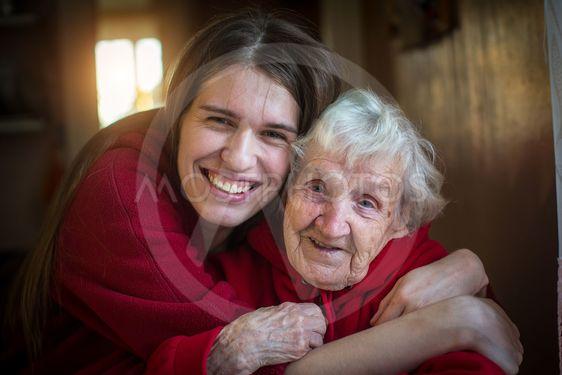 Portrait of Girl hugging her grandmother.