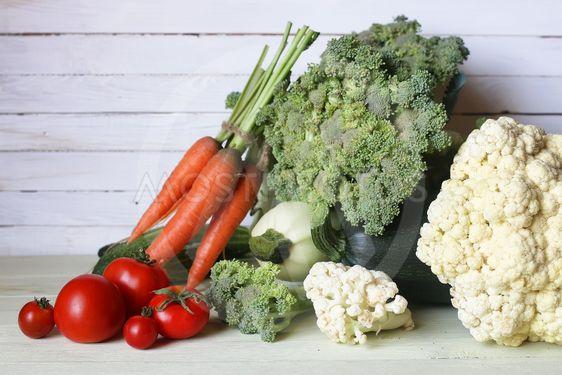 Fresh vegetables rustic wooden background