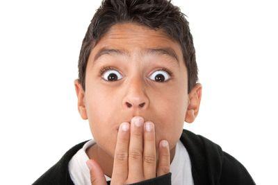 Surprised Hispanic boy